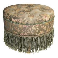 Ottoman with fringe detail and button-tufting.  Product: OttomanConstruction Material: Polyester and rayonColor: GrayFeatures: FringeDimensions: 14 H x 24 DiameterNote: Foot assembly requiredCleaning and Care: Dry clean