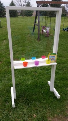 My husband and I built this outdoor easel with wood he had laying around and painted it today. It's plexiglass ($15 at Lowe's) so it wipes right off with windex. We used the cute cups we got from IKEA for $2 to hold window markers. Next they'll use paint! (Washable of course). I love it!! We love making things for our girls!