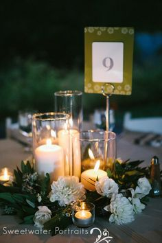 Falls Flowers | Summer wedding at the Morris Arboretum | Candle and floral wreath centerpieces with dahlias