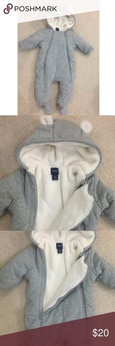 NWOT Baby Gap winter body suit Gray cotton onesie with hood lined with cream fleece. Two zippers down the middle makes for easy access to get on and off. Great for either boy or girl. Size is 3-6 months. Never used. Excellent condition. GAP One Pieces Bodysuits