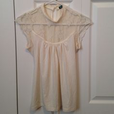 Cream lace top Adorable cream lace up to the neck short sleeve blouse. Ties in the back for a perfect fit. Tops Blouses