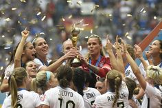USA players celebrate their victory in the final football match between USA and Japan during the 2015 FIFA Women's World Cup at the BC Place Stadium in Vancouver on July 5, 2015. USA won 5-2.