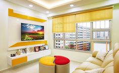 The modern interior design features bring colours– blue, yellow, green, and red – against a backdrop of white-washed wall and hint of black. Beautiful home. Modern Interior Design, Living Room Designs, Beautiful Homes, Minimalism, Bookcase, Shelves, Colours, Tv Unit, Architecture