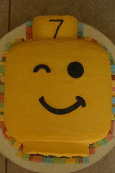 Lego cake- larger cake board covered in green lego impressioned fondant- name and number on board