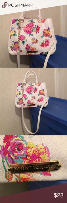 "$25 NEW betsey Johnson white floral bow satchel New! NO TAGS. Never worn! Still has plastic tag holder on strap and plastic protectors overdone of the hardware. Please see the pic of the slight blue mark on the front of the bag this is from storage and it's not very noticeable. ✔️the price in the beginning of the title of my listings is the bundle price. These prices are valid through the ""make an offer"" feature after you create a bundle. These bundle orders must be over $15. Ask me about…"