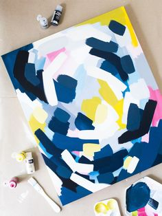 Make your own bright abstract wall art. Fun activity for an afternoon with friends!