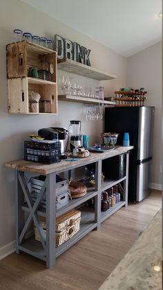 love this little kitchenette bar area made with a console plan and shelves! Rustic X beach beverage center Do It Yourself Home Projects from Ana White Sweet Home, Beverage Center, Beverage Bars, Drink Bar, Small Space Kitchen, Kitchen Ideas For Small Spaces Design, Furniture For Small Spaces, Decorating Small Spaces, Diy Casa