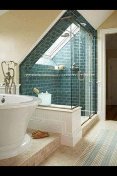 Skylight in the shower...glorious. I like the teal tiles with the cream/white.