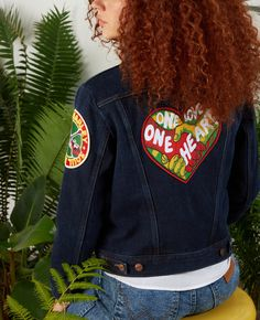 """Our women's patch jacket commemorates the life of this musical powerhouse by combining modern style with the attitude of another era. Complete with bespoke patches that nod to """"One Love"""" and """"Soul Rebel,"""" this wardrobe essential comes with the kind of staying power that'll keep you reaching for it again and again. #WranglerxBobMarley #BobMarley #Wrangler"""
