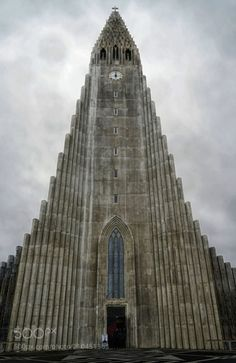 Iceland: Hallgrímskirkja, Reykjavík ▪25-ton 5275-pipe organ in front ▪Church of Hallgrímur, named for Hallgrímur Pétursson, 17c Icelandic priest & poet ▪Constructed 1945-1986 ▪Largest church in Iceland ▪6th tallest architectural structure in Iceland ▪Foreground statue of Leifur Eiriksson posed on ship's prow, 1930 gift from US, commemorating 1,000th anniversary of Iceland's parliament (Althing). | lolongan
