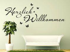 Schönes Wandtattoo Herzlich Willkommen Das Mit Kleinen Schmetterlingen  Geschmückt Ist.
