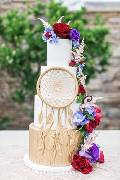 Four-tiered dream catcher-inspired wedding cake decorated with fresh flowers, created by Sweet & Saucy Shop.
