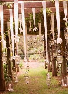 Hanging lanterns with ribbon..what's more romantic...