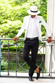 Consider wearing a white blazer and black dress pants for a sharp, fashionable look. Black leather loafers will contrast beautifully against the rest of the look. Shop this look for $332: http://lookastic.com/men/looks/hat-and-pocket-square-and-dress-shirt-and-blazer-and-watch-and-belt-and-dress-pants-and-loafers/3398 — White and Black Hat — Green Pocket Square — White Dress Shirt — White Blazer — Gold Watch — Black Leather Belt — Black Dress Pants — Black Leather Loafers