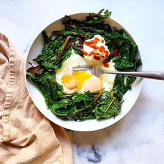 Eggs and Greens. Sauté 2 cups Swiss chard and spinach in olive oil until wilted. Crack 2 eggs in the middle of the greens and cook until the whites are set. Serve with Greek yogurt, sriracha, and cracked pepper.
