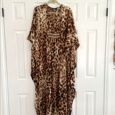 Natori brand Leopard Print Caftan The  dress  is 100% polyester and has a  decorative design with sequins and beads at the bust.  Purchased from Neiman Marcus. Label show brand as Natori.  Great condition no rips  or stains. Neiman Marcus Dresses Maxi