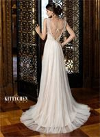 Kitty Chen Bridal - Style Cassidy Color: White, Ivory or Ice Blush Fabric: Organza
