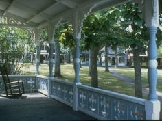Trying to determine which types of porches I like so am making a collection to figure it out.  I love the columns and the railing.