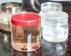 how to get old candles out of glass jars - pour boiling water into the jars allowing the candle to melt. Let sit overnight to allow the water to cool. Candle will solidify at the top and allow you to break in half to pull out. Scrub with a soft Brillo pad to get any remnants off the jar.