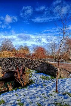 Stone bridge over the beck at the Rheged Centre, Penrith, Cumbria, England.