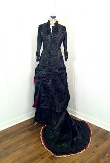 1880's, black silk with bead, tassel, and ord detailing.