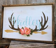 This sign comes with an artificial flower cluster of 4 (1 peachy color and 1 coral color, 2 small old white roses)silk flowers and 4 flocked silk leaves.    17in x 26in Distressed white background with walnut stained rustic frame Dusty minty turquoise lettering, brown antlers, and a golden tan arrow will be the colors if no color changes are stated at checkout  This custom designed Nursery Name Monogram sign is a great piece for any rustic , boho, shabby chic, or woodland nursery. I cus...