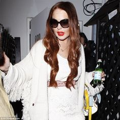 Redheads have more fun! Lindsay Lohan ditched her black hair to go back to red locks after wrapping on the Elizabeth Taylor Lifetime movie Liz & Dick on Monday