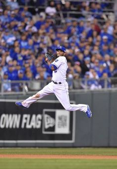 Kansas City Royals shortstop Alcides Escobar fielded the ball and tried to through out San Francisco Giants Hunter Pence who was safe at first during the sixth inning in game two of the World Series on Wednesday, October 22, 2014 at Kauffman Stadium in Kansas City, Mo.
