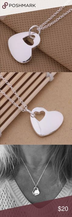 """NWOT Sterling Silver Puffed Double Heart Necklace New without tags heart pendant and delicate chain.  Sterling silver plated.  Solid polished heart pendant has cut out heart.  Chain approx 18"""".   Pendant approx 3/4"""" wide x 5/8"""" Tall. Jewelry Necklaces"""
