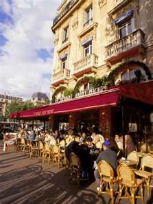 Cafe in Paris-they line the streets. People sit for hours eating and drinking coffee. Meals are a social occasion.