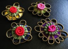 Zipper daisy and rose brooch by woolly  are fabulous!! via Flickr
