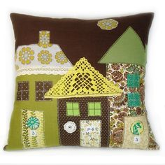 The cutest little houses!  On a pillow! artist unknown