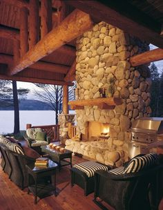 River rock fireplace in this log home porch overlooking the lake and the mountains!-SR