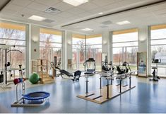 The physical therapy gym's full windows offer great views and ample natural light during exercise and mobility training.