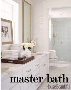 Master bath, subway tiled walls with mirrors mounted on top. Long marble counter with dual sinks. Sense of separation between shower.