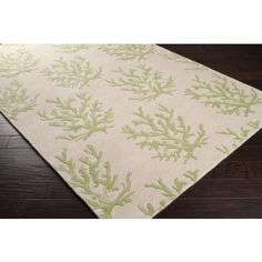 We are crazy about this fabulous hand-tufted 100% New Zealand Wool area rug with light green coral branches! #sale #coralrug #coastalrug