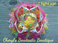 Light up Chick Easter twisted boutique bow with Pink and Yellow marabou feathers on Alligator clip. Just turn on Light by CherylsBowtasticBows