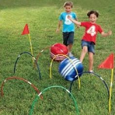 Here's another of our favorites. MagicCabin.com actually sells this kickball croquet set, but we've seen it done with hula hoops.  Cut the hoops at an angle so they are easy to press/stake into the ground. If you really want to go all out,  spray paint cheap play balls once for the ball color and then use masking tape to mask off an area to paint white stripes. - From our Pinterest board.  #pediOT #pediPT #physicaltherapy #occupationaltherapy #Padgram