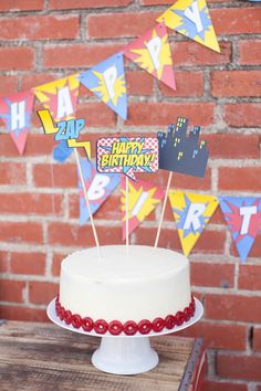 Industrial Vintage Superhero Birthday Party... love the simplicity of the cake rimmed with Lifesavers candy