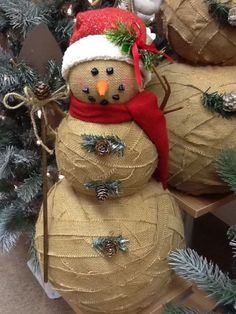 Burlap snowman..cuts strips of burlap and glue onto styrofoam balls. Decorate as you please by SusieAnneie