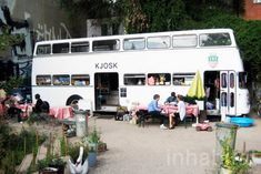 Kjosk not only sells the traditional fare of coffee, sweets, beer and pretzels, but creates an impromptu meeting space, parked in amongst shabby, laid-back gardens.    Read more: 1970s Double-Decker Bus in Berlin Transformed Into Mobile Kiosk Rosmarie Kockenberger's mobile kiosk in Berlin Kjosk – Inhabitat - Sustainable Design Innovation, Eco Architecture, Green Building