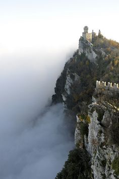 San Marino's Castle above the clouds (by Alberto Cassinari). A microstate surrounded by Italy.