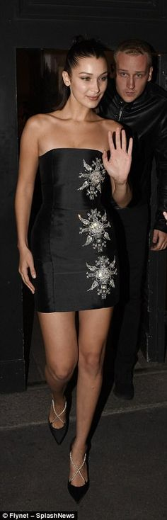 Turning heads: Bella Hadid ensured the Versace after-party was just as memorable as the show, as she stunned in two jaw-dropping ensembles in Milan on Friday