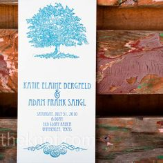 Katie had the programs printed at a local printer; she then added navy embossing glitter and a tree stamp.