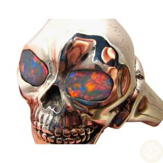 Silver Skull Ring with Red Opal Eyes.  Heavy 925 Sterling with Brilliant Black Opals.  Made to Order in your Ring Size.