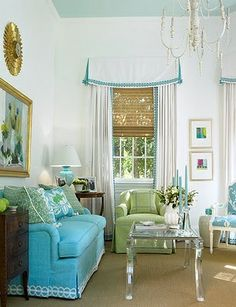 Beautiful colors - fresh and clean.  Love the trims on the window treatment and sofa, the lucite coffee table and natural run and window blinds.