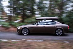 The Maserati Quattroporte.   With details from Skiguard. The first roof rack and skibox ever made
