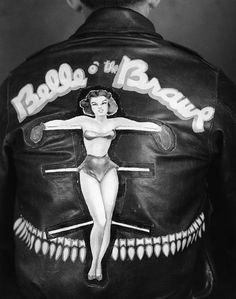 Leather jacket worn by the crew members of the Boeing B-17 Flying Fortress 'Belle O the Brawl' of the 401st Bomb Group. Photograph, 1944.