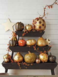 pumpkins spray painted with gold glitter. yes please?