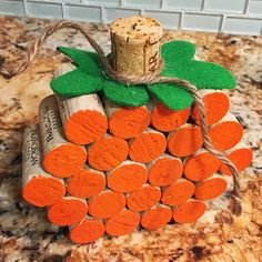 Make a fun wine cork pumpkin craft for fall or Halloween! Just hot glue corks together (4 on bottom, 5, 6, 5, 4) then paint the outsides with orange paint. Cut a cork in half and glue it with a piece of green felt to make the stem! Tie a piece of twine around it …